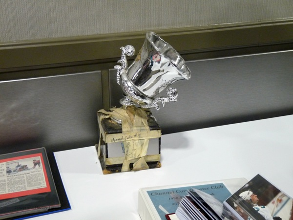 Trophy held together, barely, with masking tape